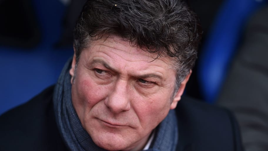 Watford's Italian head coach Walter Mazzarri awaits kick off in the English Premier League football match between Crystal Palace and Watford at Selhurst Park in south London on March 18, 2017. / AFP PHOTO / Glyn KIRK / RESTRICTED TO EDITORIAL USE. No use with unauthorized audio, video, data, fixture lists, club/league logos or 'live' services. Online in-match use limited to 75 images, no video emulation. No use in betting, games or single club/league/player publications.  /         (Photo credit should read GLYN KIRK/AFP/Getty Images)