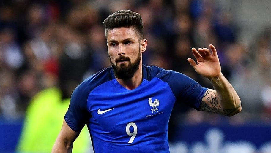 France's forward Olivier Giroud controls the ball during the friendly football match France vs Spain on March 28, 2017 at the Stade de France stadium in Saint-Denis, north of Paris.  / AFP PHOTO / FRANCK FIFE        (Photo credit should read FRANCK FIFE/AFP/Getty Images)