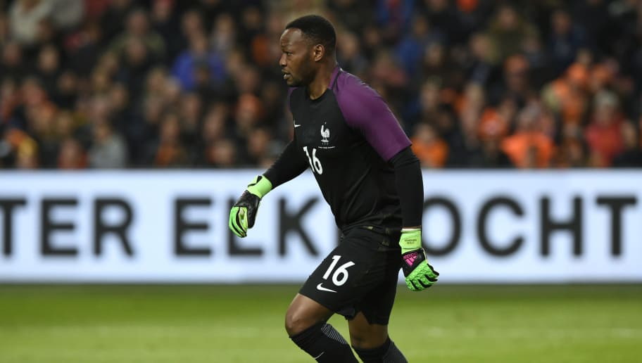 France's goalkeeper Steve Mandanda controls the ball  during the friendly football match between the Netherlands and France at the Amsterdam ArenA, on March 25, 2016, in Amsterdam. AFP PHOTO / JOHN THYS / AFP / JOHN THYS        (Photo credit should read JOHN THYS/AFP/Getty Images)