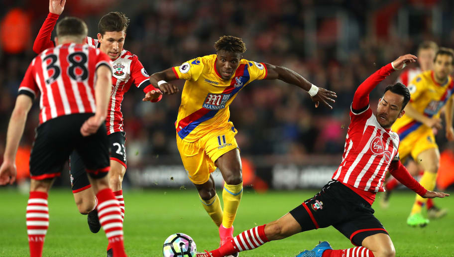 SOUTHAMPTON, ENGLAND - APRIL 05: Pierre-Emile Hojbjerg of Southampton (L) and Maya Yoshida of Southampton (R) attempt to tackle Wilfried Zaha of Crystal Palace during the Premier League match between Southampton and Crystal Palace at St Mary's Stadium on April 5, 2017 in Southampton, England.  (Photo by Warren Little/Getty Images)