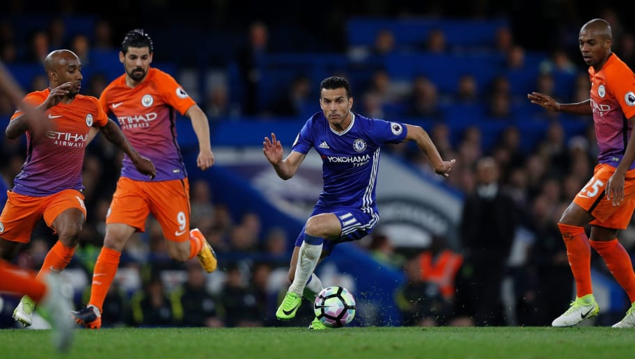 Chelsea's Spanish midfielder Pedro (C) runs between Manchester City's English midfielder Fabian Delph (L) , Manchester City's Spanish midfielder Nolito (2L) and Manchester City's Brazilian midfielder Fernandinho during the English Premier League football match between Chelsea and Manchester City at Stamford Bridge in London on April 5, 2017. Chelsea won the match 2-1. / AFP PHOTO / Adrian DENNIS / RESTRICTED TO EDITORIAL USE. No use with unauthorized audio, video, data, fixture lists, club/league logos or 'live' services. Online in-match use limited to 75 images, no video emulation. No use in betting, games or single club/league/player publications.  /         (Photo credit should read ADRIAN DENNIS/AFP/Getty Images)