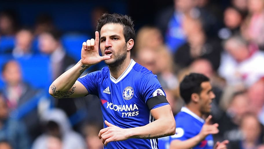 Chelsea's Spanish midfielder Cesc Fabregas celebrates after scoring the opening goal of the English Premier League football match between Chelsea and Crystal Palace at Stamford Bridge in London on April 1, 2017. / AFP PHOTO / Glyn KIRK / RESTRICTED TO EDITORIAL USE. No use with unauthorized audio, video, data, fixture lists, club/league logos or 'live' services. Online in-match use limited to 75 images, no video emulation. No use in betting, games or single club/league/player publications.  /         (Photo credit should read GLYN KIRK/AFP/Getty Images)
