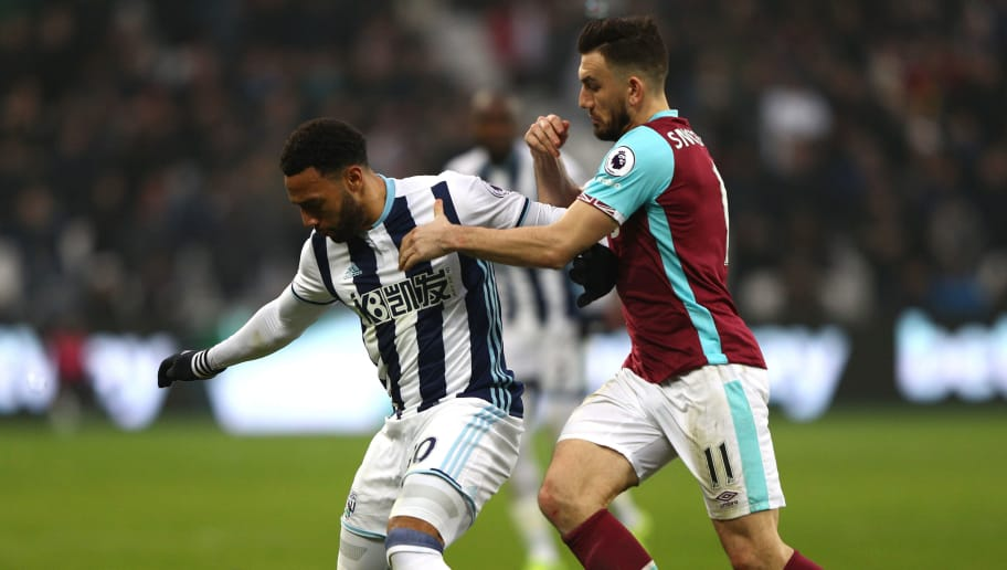 STRATFORD, ENGLAND - FEBRUARY 11:  Matt Phillips of West Bromwich Albion controls the ball under pressure of Robert Snodgrass of West Ham United during the Premier League match between West Ham United and West Bromwich Albion at London Stadium on February 11, 2017 in Stratford, England.  (Photo by Ian Walton/Getty Images)