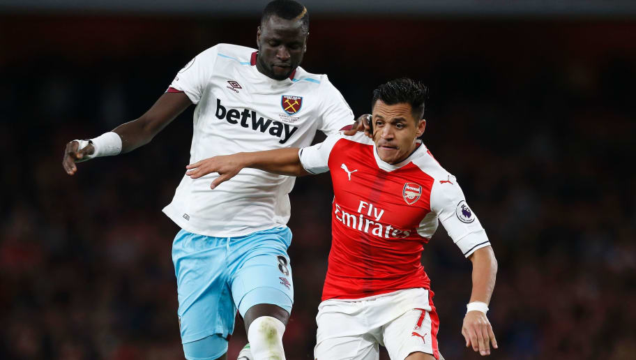 Arsenal's Chilean striker Alexis Sanchez (R) vies with West Ham United's Senegalese midfielder Cheikhou Kouyate during the English Premier League football match between Arsenal and West Ham United at the Emirates Stadium in London on April 5, 2017.  Arsenal won the match 3-0. / AFP PHOTO / Ian KINGTON / RESTRICTED TO EDITORIAL USE. No use with unauthorized audio, video, data, fixture lists, club/league logos or 'live' services. Online in-match use limited to 75 images, no video emulation. No use in betting, games or single club/league/player publications.  /         (Photo credit should read IAN KINGTON/AFP/Getty Images)