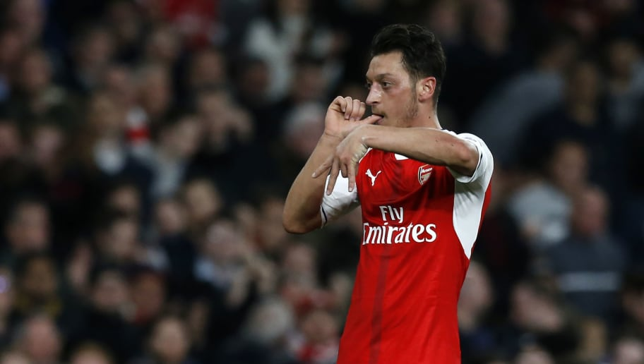 Arsenal's German midfielder Mesut Ozil celebrates after scoring the opening goal of the English Premier League football match between Arsenal and West Ham United at the Emirates Stadium in London on April 5, 2017.  / AFP PHOTO / Ian KINGTON / RESTRICTED TO EDITORIAL USE. No use with unauthorized audio, video, data, fixture lists, club/league logos or 'live' services. Online in-match use limited to 75 images, no video emulation. No use in betting, games or single club/league/player publications.  /         (Photo credit should read IAN KINGTON/AFP/Getty Images)