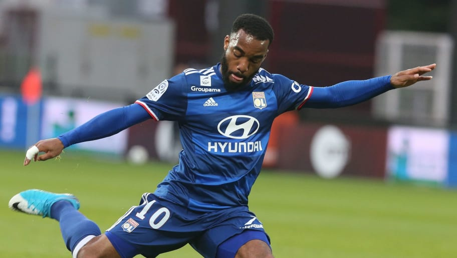 Lyon's French forward Alexandre Lacazette kicks the ball during the French L1 football match between Metz and Lyon on April 5, 2017 at the Saint-Symphorien Stadium in Metz. / AFP PHOTO / FRANCOIS NASCIMBENI        (Photo credit should read FRANCOIS NASCIMBENI/AFP/Getty Images)