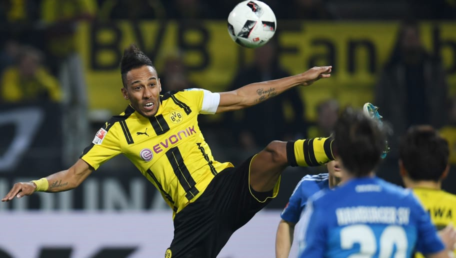Dortmund's Gabonese striker Pierre-Emerick Aubameyang and Hamburg's defender Matthias Ostrzolek vie for the ball during the German First division Bundesliga football match BVB Borussia Dortmund v Hamburg SV in Dortmund, western Germany on April 4, 2017. / AFP PHOTO / PATRIK STOLLARZ / RESTRICTIONS: DURING MATCH TIME: DFL RULES TO LIMIT THE ONLINE USAGE TO 15 PICTURES PER MATCH AND FORBID IMAGE SEQUENCES TO SIMULATE VIDEO. == RESTRICTED TO EDITORIAL USE == FOR FURTHER QUERIES PLEASE CONTACT DFL DIRECTLY AT + 49 69 650050         (Photo credit should read PATRIK STOLLARZ/AFP/Getty Images)