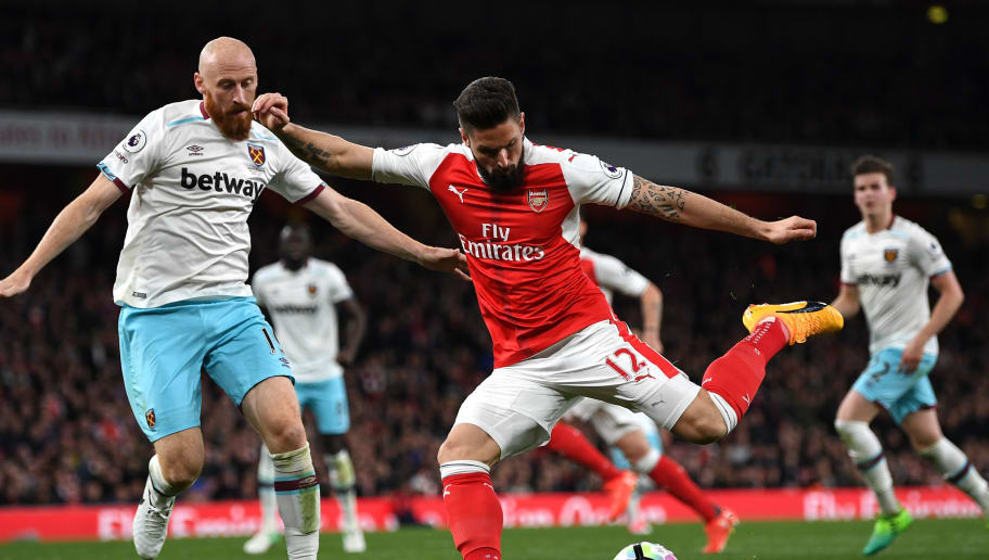 LONDON, ENGLAND - APRIL 05:  Olivier Giroud of Arsenal shoots during the Premier League match between Arsenal and West Ham United at the Emirates Stadium on April 5, 2017 in London, England.  (Photo by Shaun Botterill/Getty Images,)