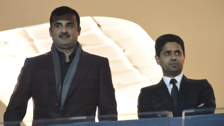 Qatar Emir Tamim ben Hamad Al Thani (L) and Paris Saint-Germain's president Nasser Al-Khelaifi are pictured ahead of the UEFA Champions League football match Paris Saint-Germain (PSG) vs Real Madrid, on October 21, 2015 at the Parc des Princes stadium in Paris.  AFP PHOTO / MIGUEL MEDINA        (Photo credit should read MIGUEL MEDINA/AFP/Getty Images)
