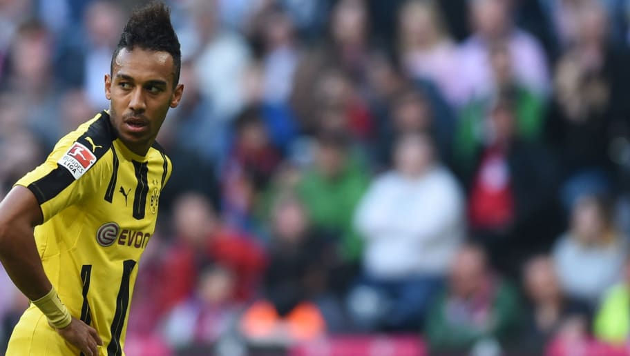 Dortmund's Gabonese striker Pierre-Emerick Aubameyang reacts during the German first division Bundesliga football match FC Bayern Munich v BVB Borussia Dortmund in Munich, southern Germany, on April 8, 2017. / AFP PHOTO / Christof STACHE / RESTRICTIONS: DURING MATCH TIME: DFL RULES TO LIMIT THE ONLINE USAGE TO 15 PICTURES PER MATCH AND FORBID IMAGE SEQUENCES TO SIMULATE VIDEO. == RESTRICTED TO EDITORIAL USE == FOR FURTHER QUERIES PLEASE CONTACT DFL DIRECTLY AT + 49 69 650050         (Photo credit should read CHRISTOF STACHE/AFP/Getty Images)