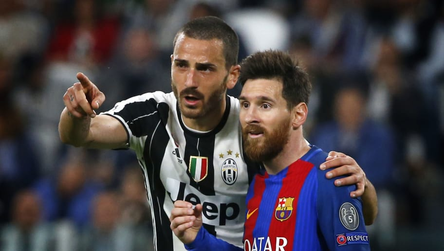 Juventus' defender Leonardo Bonucci (L) speaks to Barcelona's forward Lionel Messi from Argentina during the UEFA Champions League quarter final first leg football match Juventus vs Barcelona, on April 11, 2017 at the Juventus stadium in Turin.  / AFP PHOTO / Marco BERTORELLO        (Photo credit should read MARCO BERTORELLO/AFP/Getty Images)