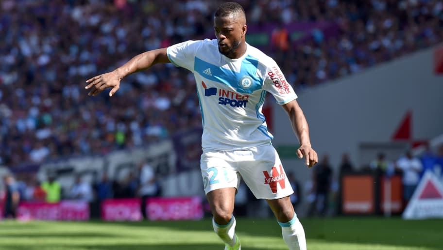 Marseille's French defender Patrice Evra runs with the ball during the French L1 football match between Toulouse and Marseille, on April 9, 2017 at the Municipal Stadium in Toulouse, southern France. / AFP PHOTO / REMY GABALDA        (Photo credit should read REMY GABALDA/AFP/Getty Images)