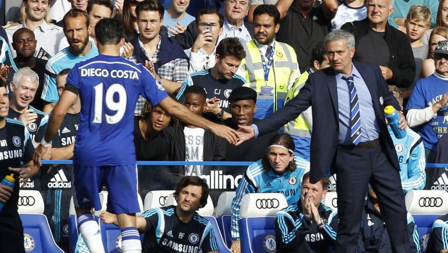 Chelseas Brazilian-born Spanish striker Diego Costa (L) gestures to Chelsea's Portuguese manager Jose Mourinho after being substituted during the English Premier League football match between Chelsea and Swansea City at Stamford Bridge in London on September 13, 2014.  Chelsea won 4-1.  AFP PHOTO/IAN KINGTON - RESTRICTED TO EDITORIAL USE. No use with unauthorized audio, video, data, fixture lists, club/league logos or live services. Online in-match use limited to 45 images, no video emulation. No use in betting, games or single club/league/player publications.        (Photo credit should read IAN KINGTON/AFP/Getty Images)