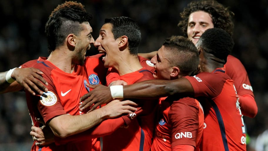 Paris Saint-Germain's Argentinian forward Angel Di Maria (C) celebrates with his teammates after scoring a goal during the French L1 football match between Angers and Paris Saint-Germain on April 14, 2017 at the Raymond Kopa Stadium in Angers, western France. / AFP PHOTO / FRED TANNEAU        (Photo credit should read FRED TANNEAU/AFP/Getty Images)