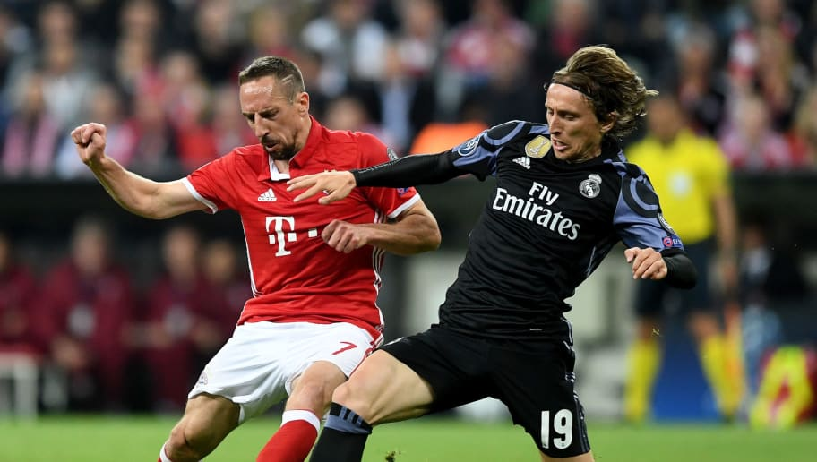 MUNICH, GERMANY - APRIL 12: Franck Ribery of Bayern and Luka Modric of Real Madrid during the UEFA Champions League Quarter Final first leg match between FC Bayern Muenchen and Real Madrid CF at Allianz Arena on April 12, 2017 in Munich, Germany.  (Photo by Lennart Preiss/Bongarts/Getty Images)