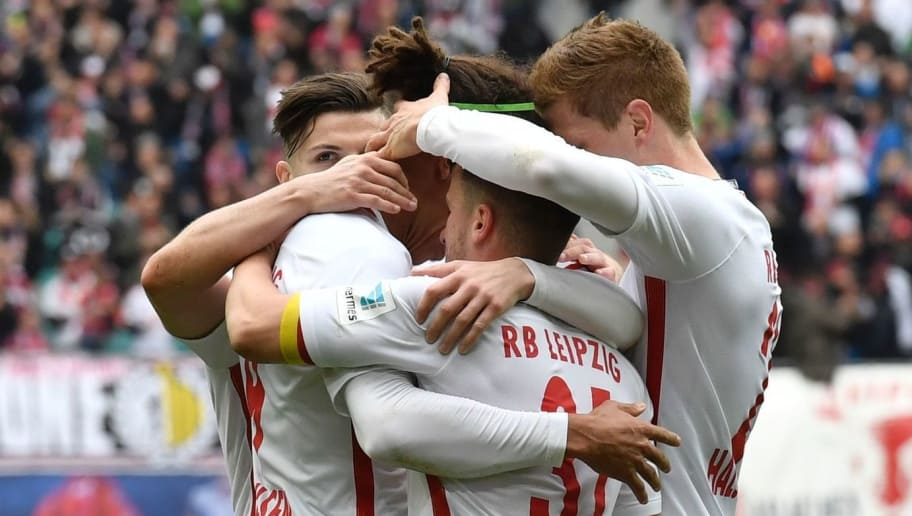 Leipzig players celebrate after Leipzig's Danish forward Yussuf Poulsen scored the first goal during the Bundesliga match RB Leipzig vs SC Freiburg in Leipzig on April 15, 2017.  Leipzig won 4 to 0, earning themselves a spot in next season's champions league. / AFP PHOTO / John MACDOUGALL / RESTRICTIONS: DURING MATCH TIME: DFL RULES TO LIMIT THE ONLINE USAGE TO 15 PICTURES PER MATCH AND FORBID IMAGE SEQUENCES TO SIMULATE VIDEO. == RESTRICTED TO EDITORIAL USE == FOR FURTHER QUERIES PLEASE CONTACT DFL DIRECTLY AT + 49 69 650050         (Photo credit should read JOHN MACDOUGALL/AFP/Getty Images)