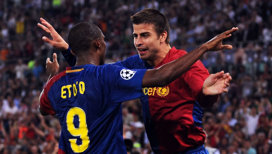 ROME - MAY 27:  Gerard Pique of Barcelona and his team mate Samuel Eto'o celebrate after Lionel Messi scored the second goal for Barcelona during the UEFA Champions League Final match between Barcelona and Manchester United at the Stadio Olimpico on May 27, 2009 in Rome, Italy.  (Photo by Jasper Juinen/Getty Images)