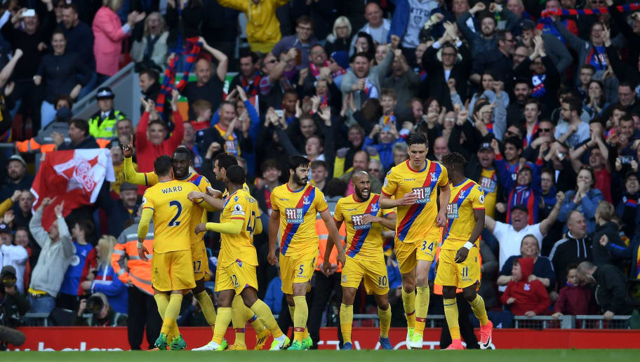 LIVERPOOL, ENGLAND - APRIL 23: Christian Benteke (2nd L) of Crystal Palace celebrates his side's second goal with his team mates during the Premier League match between Liverpool and Crystal Palace at Anfield on April 23, 2017 in Liverpool, England.  (Photo by Laurence Griffiths/Getty Images)
