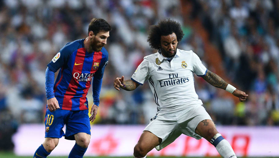 MADRID, SPAIN - APRIL 23:  Lionel Messi of FC Barcelona competes for the ball with Marcelo Vieira of Real Madrid CF during the La Liga match between Real Madrid CF and FC Barcelona at the Santiago Bernabeu stadium on April 23, 2017 in Madrid, Spain.  (Photo by David Ramos/Getty Images)
