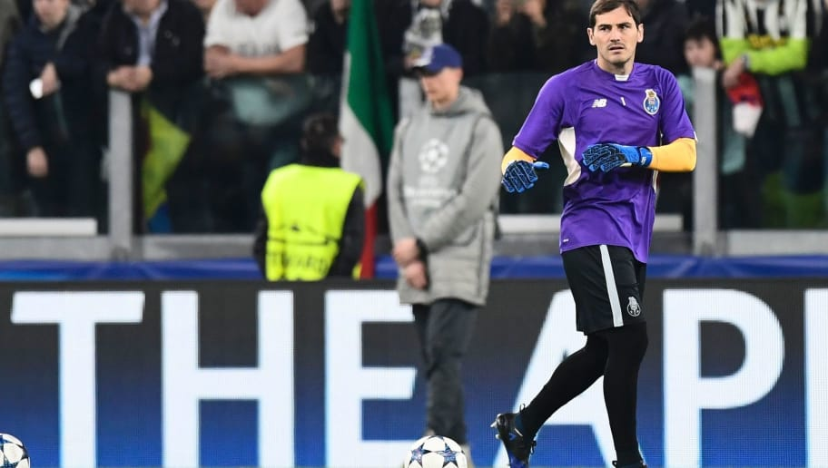 Porto's Spanish goalkeeper Iker Casillas warms up before the UEFA Champions League football match Juventus vs FC Porto on March 14, 2017 at the Juventus stadium in Turin. / AFP PHOTO / MIGUEL MEDINA        (Photo credit should read MIGUEL MEDINA/AFP/Getty Images)