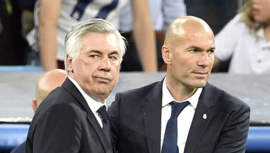 TOPSHOT - Bayern Munich's Italian head coach Carlo Ancelotti shakes hands with Real Madrid's French coach Zinedine Zidane after during the UEFA Champions League quarter-final second leg football match Real Madrid vs FC Bayern Munich at the Santiago Bernabeu stadium in Madrid in Madrid on April 18, 2017. / AFP PHOTO / GERARD JULIEN        (Photo credit should read GERARD JULIEN/AFP/Getty Images)