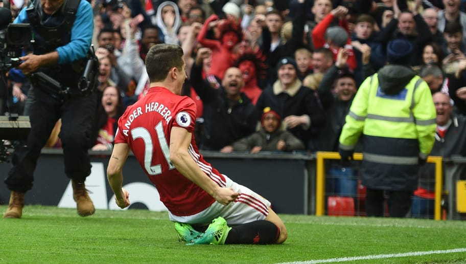 Manchester United's Spanish midfielder Ander Herrera celebrates scoring their second goal during the English Premier League football match between Manchester United and Chelsea at Old Trafford in Manchester, north west England, on April 16, 2017. / AFP PHOTO / Oli SCARFF / RESTRICTED TO EDITORIAL USE. No use with unauthorized audio, video, data, fixture lists, club/league logos or 'live' services. Online in-match use limited to 75 images, no video emulation. No use in betting, games or single club/league/player publications.  /         (Photo credit should read OLI SCARFF/AFP/Getty Images)
