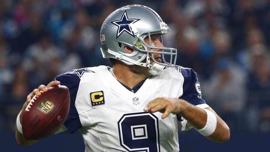 ARLINGTON, TX - NOVEMBER 26: Tony Romo #9 of the Dallas Cowboys looks to throw against the Carolina Panthers in the first quarter at AT&T Stadium on November 26, 2015 in Arlington, Texas. (Photo by Tom Pennington/Getty Images)