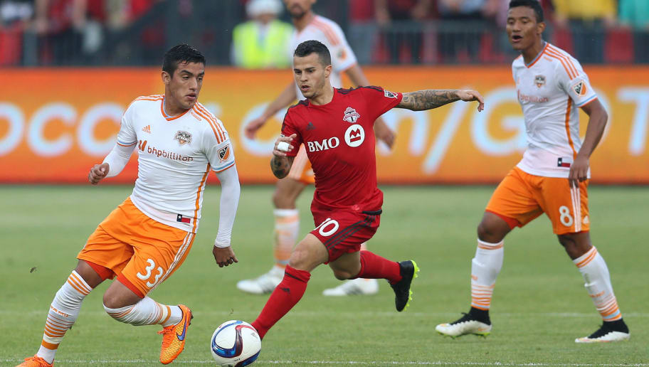 TORONTO, ON - MAY 10:  Sebastian Giovinco #10 of Toronto FC chases Leonel Miranda #33 of the Houston Dynamo during an MLS soccer game at BMO Field on May 10, 2015 in Toronto, Ontario, Canada.  (Photo by Vaughn Ridley/Getty Images)