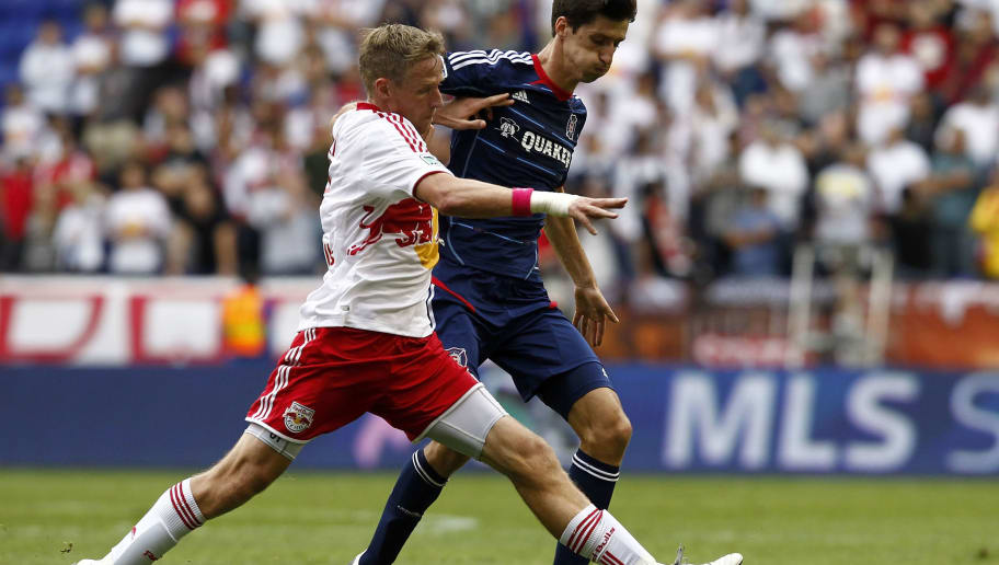 HARRISON, NJ - OCTOBER 06:  Jan Gunnar Solli #8 of New York Red Bulls fights for the ball with Alvaro Fernandez #4 of Chicago Fire during their match at Red Bull Arena on October 6, 2012 in Harrison, New Jersey.  (Photo by Jeff Zelevansky/Getty Images)