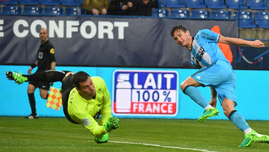 Marseille's French midfielder Florian Thauvin (R) scores past Caen's French goalkeeper Remy Vercoutre during the French L1 football match Caen (SMC) vs Marseille (OM) on April 30, 2017 at the Michel-d'Ornano stadium, in Caen, northwestern France.  / AFP PHOTO / JEAN-FRANCOIS MONIER        (Photo credit should read JEAN-FRANCOIS MONIER/AFP/Getty Images)