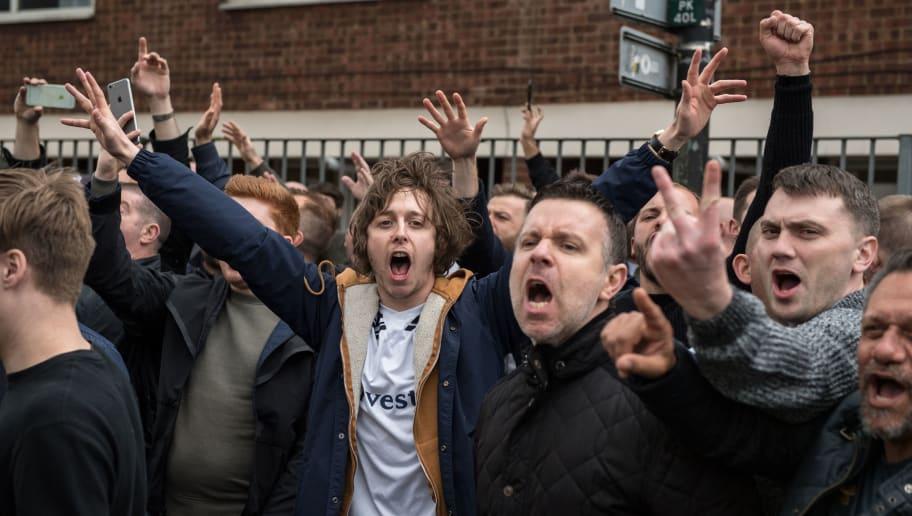 Tottenham Hotspur football club fans shout and gesture towards Arsenal supporters from behind a police line as Arsenal fans are escorted by police past Tottenham fans before the English Premier League football match between Tottenham Hotspur and Arsenal at White Hart Lane in London, on April 30, 2017.  Tottenham will play next season at Wembley stadium as White Hart Lane stadium is demolished and their new 400 million pound home built on the same extended site. Due to be completed for the 2018-19 season, the new stadium will seat 61,000 - up from present capacity of 36,000.   / AFP PHOTO / CHRIS J RATCLIFFE        (Photo credit should read CHRIS J RATCLIFFE/AFP/Getty Images)