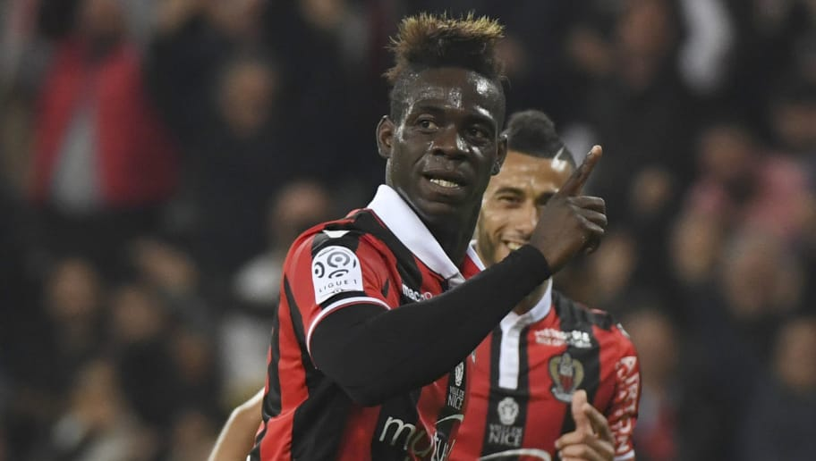Nice's Italian forward Mario Balotelli celebrates after scoring a goal during the French L1 football match Nice (OGCN) vs Paris Saint Germain (PSG) on April 30, 2017 at the 'Allianz Riviera' stadium in Nice, southeastern France.   / AFP PHOTO / Yann COATSALIOU        (Photo credit should read YANN COATSALIOU/AFP/Getty Images)
