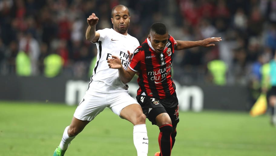 Nice's Brazilian defender Dalbert Henrique (R) vies with Paris Saint-Germain's Brazilian midfielder Lucas Moura (L) during the French L1 football match Nice (OGCN) vs Paris Saint Germain (PSG) on April 30, 2017 at the 'Allianz Riviera' stadium in Nice, southeastern France.   / AFP PHOTO / VALERY HACHE        (Photo credit should read VALERY HACHE/AFP/Getty Images)