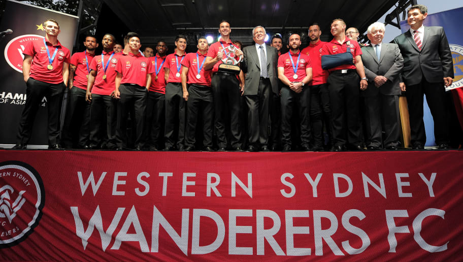 SYDNEY, AUSTRALIA - NOVEMBER 10:  Wanderers players and staff celebrate on stage during the celebration for Western Sydney Wanderers AFC champions league success at Parramatta Centenary Square on November 10, 2014 in Sydney, Australia.  (Photo by Brett Hemmings/Getty Images)