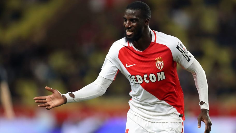 Monaco's French midfielder Tiemoue Bakayoko celebrates after scoring a goal during the French L1 football match between Monaco (ASM) and Caen (SMC) on December 21, 2016 at the Louis II Stadium in Monaco. / AFP / VALERY HACHE        (Photo credit should read VALERY HACHE/AFP/Getty Images)