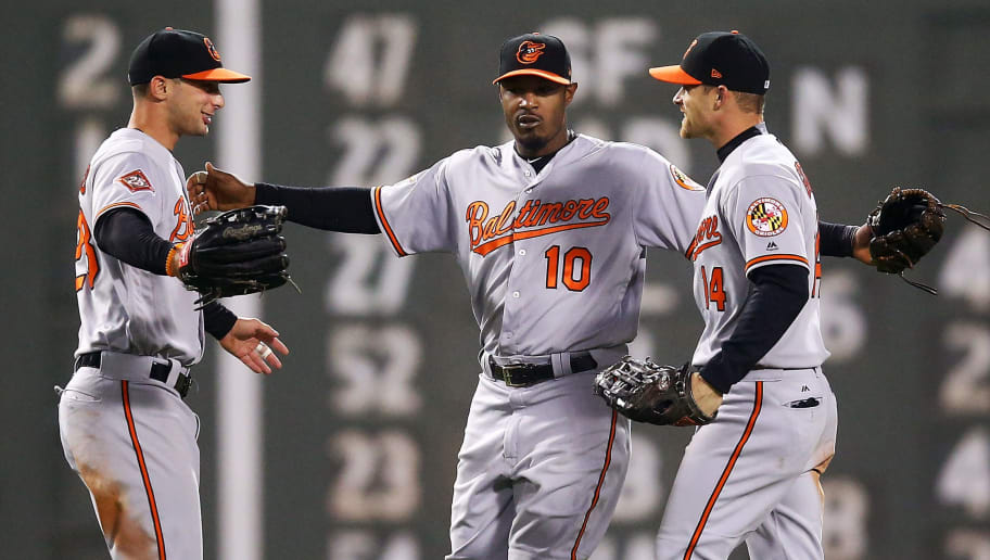 BOSTON, MA - MAY 01:  Joey Rickard #23, Adam Jones #10 and Craig Gentry #14 of the Baltimore Orioles embrace after their victory over the Boston Red Sox at Fenway Park on May 1, 2017 in Boston, Massachusetts.  (Photo by Adam Glanzman/Getty Images)