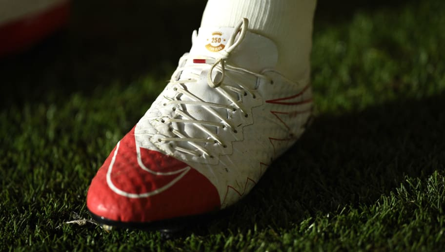 27e434698e6c5 Manchester United's English striker Wayne Rooney wears boots celebrating  his 250 goals for Manchester during the