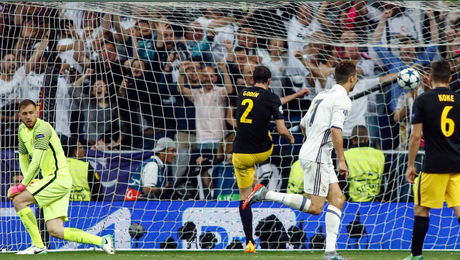 Real Madrid's Portuguese forward Cristiano Ronaldo (2R) scores a goal during the UEFA Champions League semifinal first leg football match Real Madrid CF vs Club Atletico de Madrid at the Santiago Bernabeu stadium in Madrid, on May 2, 2017. / AFP PHOTO / OSCAR DEL POZO        (Photo credit should read OSCAR DEL POZO/AFP/Getty Images)