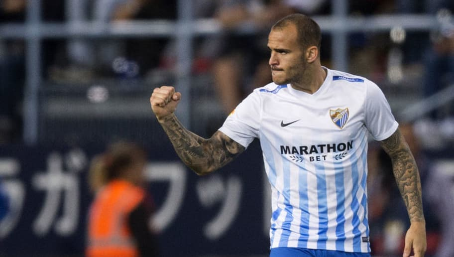 Malaga's forward Sandro Ramirez celebrates after scoring during the Spanish league football match Malaga CF vs Sevilla FC at La Rosaleda stadium in Malaga on May 1, 2017. / AFP PHOTO / JORGE GUERRERO        (Photo credit should read JORGE GUERRERO/AFP/Getty Images)
