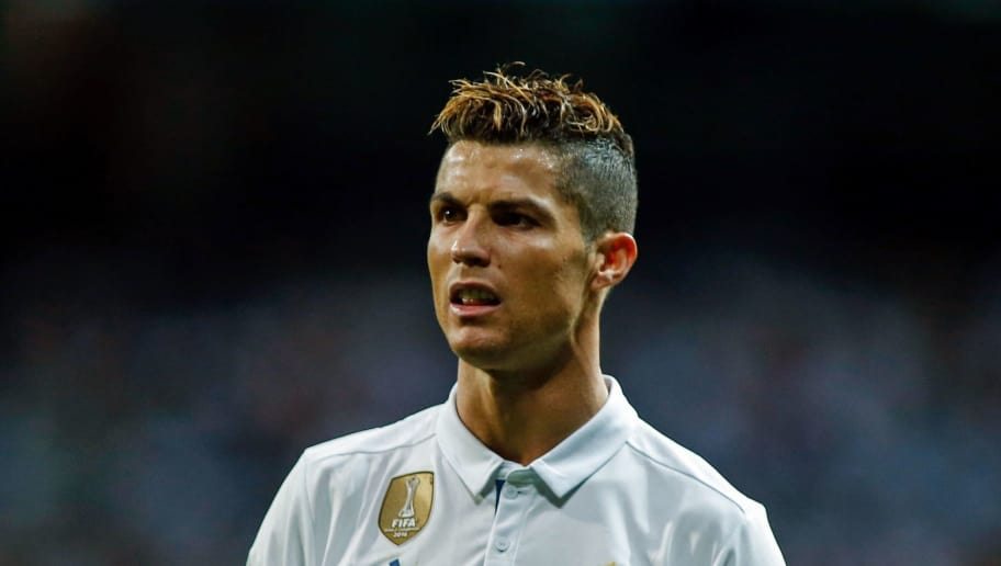 Real Madrid's portuguese forward Cristiano Ronaldo looks on during the UEFA Champions League semi-final first leg football match Real Madrid vs Atletico de Madrid at the Santiago Bernabeu stadium in Madrid on May 2, 2017. / AFP PHOTO / OSCAR DEL POZO        (Photo credit should read OSCAR DEL POZO/AFP/Getty Images)