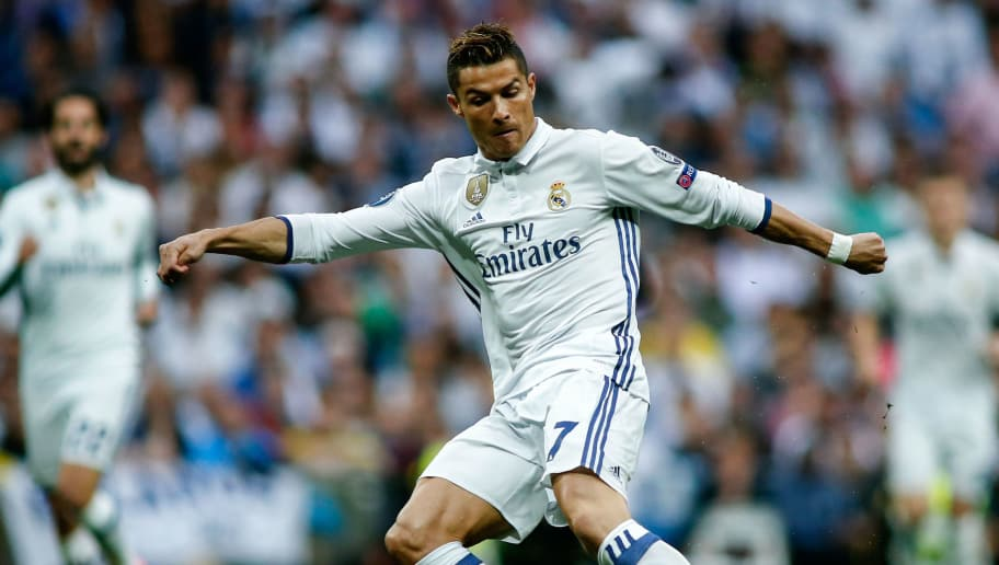 Real Madrid's Portuguese forward Cristiano Ronaldo kicks the ball during the UEFA Champions League semi-final first leg football match Real Madrid vs Atletico de Madrid at the Santiago Bernabeu stadium in Madrid on May 2, 2017. / AFP PHOTO / OSCAR DEL POZO        (Photo credit should read OSCAR DEL POZO/AFP/Getty Images)