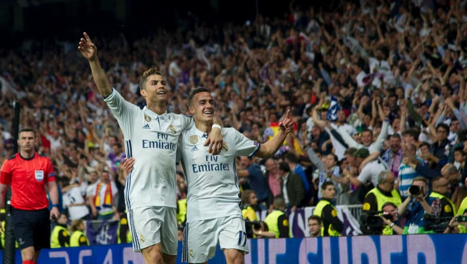Real Madrid's Portuguese forward Cristiano Ronaldo (L) and Real Madrid's midfielder Lucas Vazquez celebrate their 3-0 victory over Atletico at the end of the UEFA Champions League semifinal first leg football match Real Madrid CF vs Club Atletico de Madrid at the Santiago Bernabeu stadium in Madrid, on May 2, 2017. / AFP PHOTO / CURTO DE LA TORRE        (Photo credit should read CURTO DE LA TORRE/AFP/Getty Images)