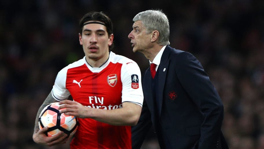 LONDON, ENGLAND - MARCH 11:  Arsene Wenger, Manager of Arsenal gives instructions as Hector Bellerin of Arsenal takes a throw in during The Emirates FA Cup Quarter-Final match between Arsenal and Lincoln City at Emirates Stadium on March 11, 2017 in London, England.  (Photo by Ian Walton/Getty Images)