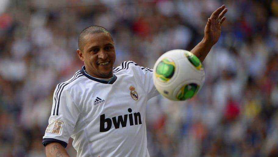 Real Madrid's Roberto Carlos eyes the ball during the Corazon Classic Match 2013 - Veracruz charity football match Real Madrid Legends vs Juventus Turin Veterans at the Santiago Bernabeu stadium in Madrid on June 9, 2013.   AFP PHOTO/ PIERRE-PHILIPPE MARCOU        (Photo credit should read PIERRE-PHILIPPE MARCOU/AFP/Getty Images)