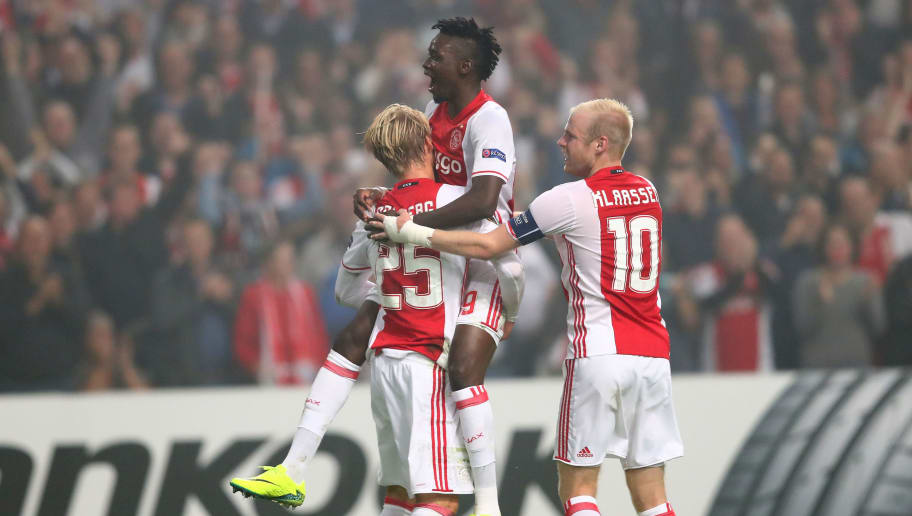 AMSTERDAM, NETHERLANDS - SEPTEMBER 29:  (L-R) Kasper Dolberg #25 of Ajax is congratulated by teammates Bertrand Traore and Davy Klaassen of Ajax after scoring the opening goal during the UEFA Europa League group G match between AFC Ajax and  R. Standard de Liege at the Amsterdam Arena on September 29, 2016 in Amsterdam, Netherlands.  (Photo by Dean Mouhtaropoulos/Getty Images)