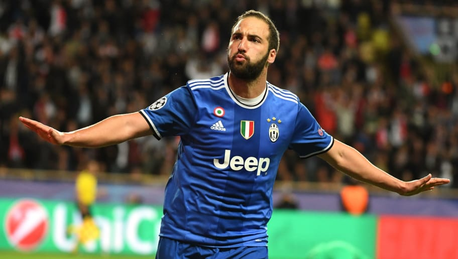 Juventus' Argentinian forward Gonzalo Higuain reacts after scoring a second goal during the UEFA Champions League semi-final first leg football match Monaco versus Juventus at the Stade Louis II stadium in Monaco on May 3, 2017. / AFP PHOTO / PASCAL GUYOT        (Photo credit should read PASCAL GUYOT/AFP/Getty Images)