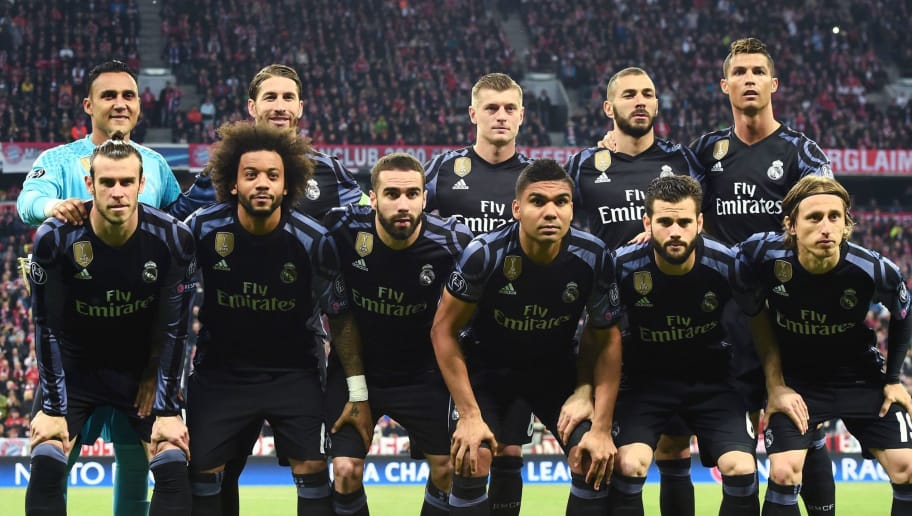 The team of Real Madrid, poses for a group photo prior the UEFA Champions League 1st leg quarter-final football match FC Bayern Munich v Real Madrid in Munich, southen Germany on April 12, 2017. Front row (L-R) Real Madrid's Welsh forward Gareth Bale, Real Madrid's Brazilian defender Marcelo, Real Madrid's defender Dani Carvajal, Real Madrid's Brazilian midfielder Casemiro, Real Madrid's defender Nacho Fernandez and Real Madrid's Croatian midfielder Luka Modric. Top row (L-R) Real Madrid's Costa Rican goalkeeper Keylor Navas, Real Madrid's defender Sergio Ramos, Real Madrid's German midfielder Toni Kroos, Real Madrid's French forward Karim Benzema and Real Madrid's Portuguese forward Cristiano Ronaldo   Security was ratcheted up in Munich, one day after three explosions rocked the team bus of German football club Borussia Dortmund minutes after the bus set off to a planned Champions League game against Monaco on Tuesday night (April 11, 2017). / AFP PHOTO / Christof STACHE        (Photo credit should read CHRISTOF STACHE/AFP/Getty Images)