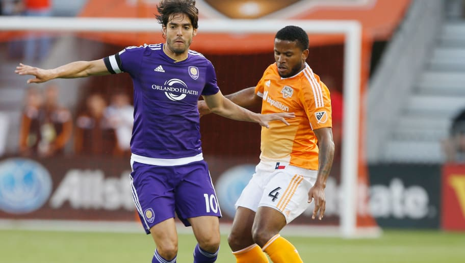 HOUSTON, TX - MARCH 13:  Kaka #10 of the Orlando City SC battles for the ball with Jermaine Taylor #4 of Houston Dynamo during their game at BBVA Compass Stadium on March 13, 2015 in Houston, Texas.  (Photo by Scott Halleran/Getty Images)