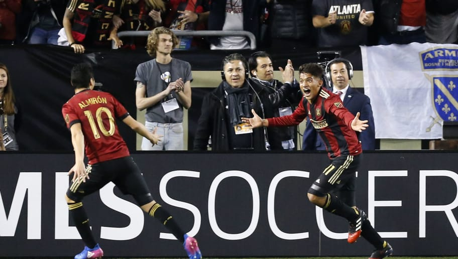 ATLANTA, GA - MARCH 05:  Midfielder Yamil Asad #11 of Atlanta United (right) celebrates with midfielder Miguel Almiron #10 after Asad scores the first goal of the game, and the first goal in Atlanta United history, during the game against the New York Red Bulls at Bobby Dodd Stadium on March 5, 2017 in Atlanta, Georgia.  (Photo by Mike Zarrilli/Getty Images)