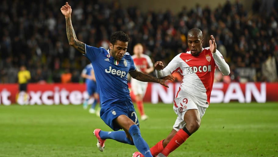 Juventus' Brazilian defender Dani Alves (L) and Monaco's defender Djibril Sidibe vie for the ball during the UEFA Champions League semi-final first leg football match Monaco vs Juventus at the Stade Louis II stadium in Monaco on May 3, 2017.  / AFP PHOTO / BORIS HORVAT        (Photo credit should read BORIS HORVAT/AFP/Getty Images)